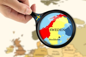 Magnifying glass over a map of Sweden